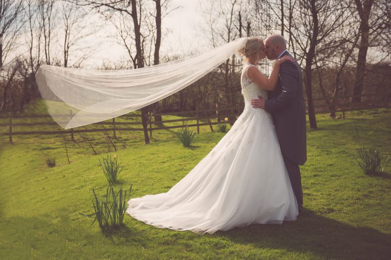 bride groom veil kiss Charnock Farm