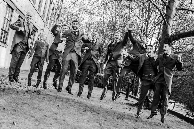 groomsmen fun jumping