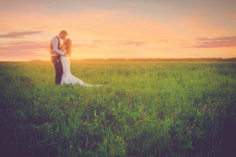 bride groom portrait pink sunset