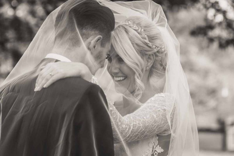 natural bride groom portrait veil