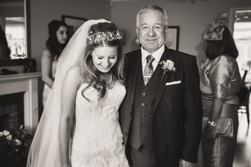 proud dad and bride