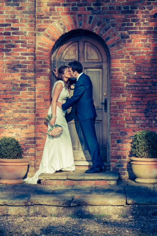 bride groom kiss doorway