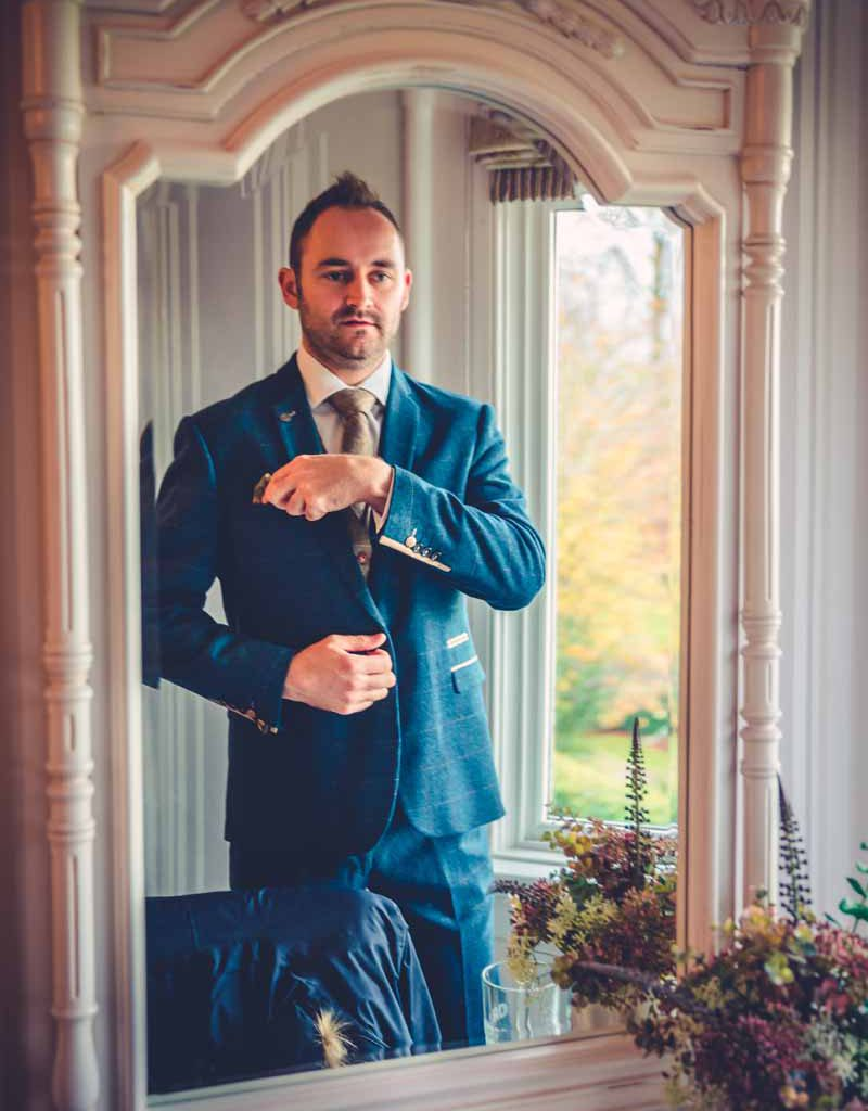 groom getting ready at falcon manor