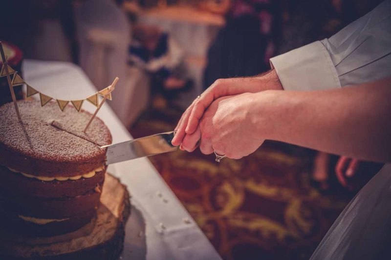 cutting wedding cake at worsley marriott